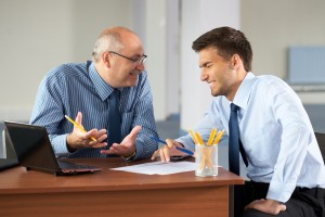 http://www.dreamstime.com/stock-images-two-businessman-laptop-office-as-background-image21652014